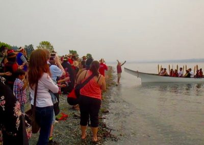 Welcoming one of the canoes to the traditional territory on Quadra Island